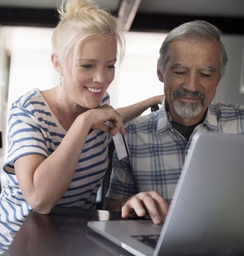 Father and Daughter Looking at Computer