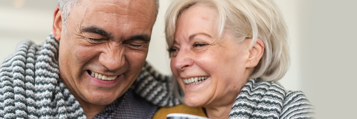 Elderly Couple Hugging and Smiling up Close
