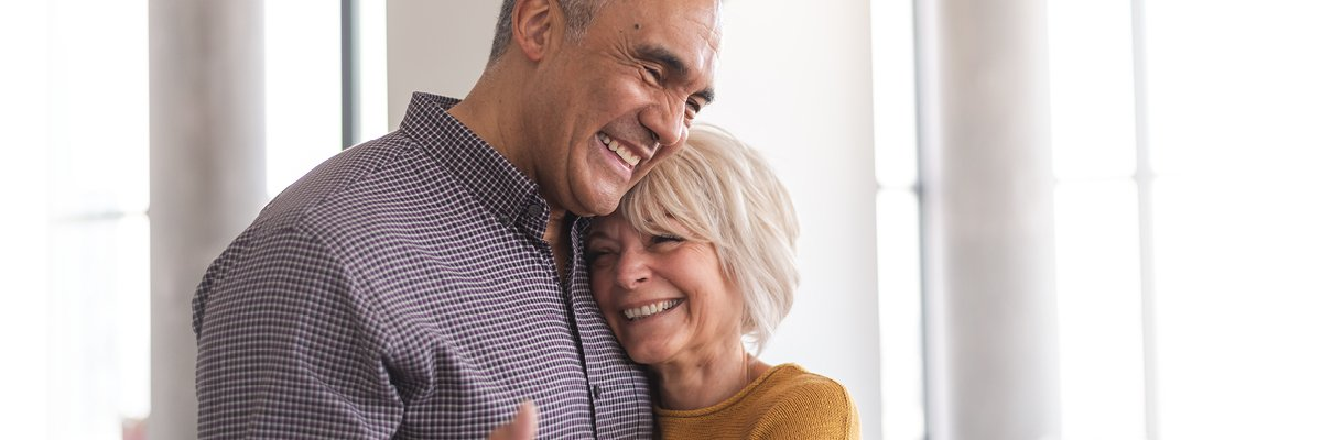Elderly Couple Side Hug and Smiling